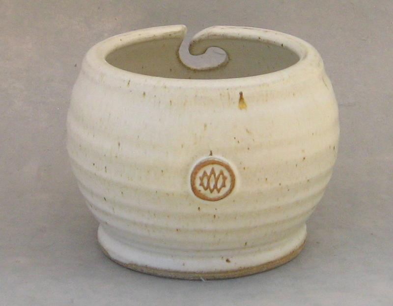 white pottery yarn bowl