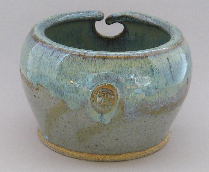 northern lights with grey bottom stoneware glaze